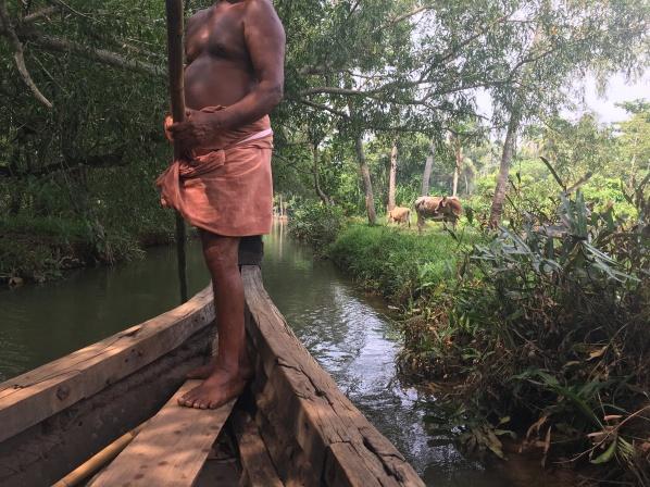 Kerala backwaters half naked man